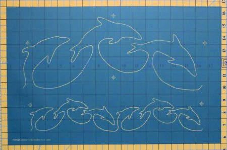 Interlocking dolphin stencil